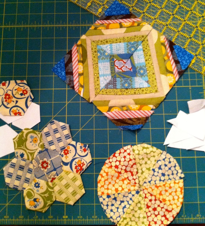 hexagons and pie wedges are hand pieced. the string quilt block was machine sewn.